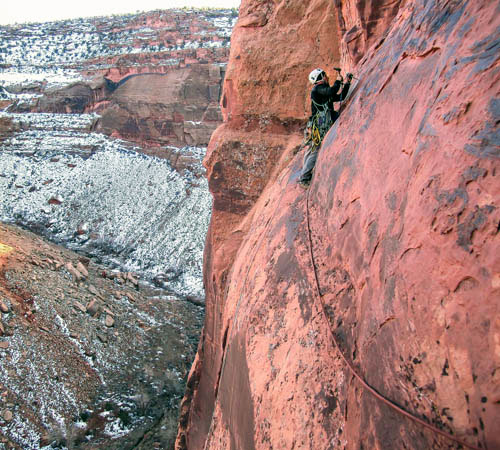 Marcus runs it out and hand-drills a bolt on lead while establishing a new route in the desert. Photo: Marcus Garcia collection.