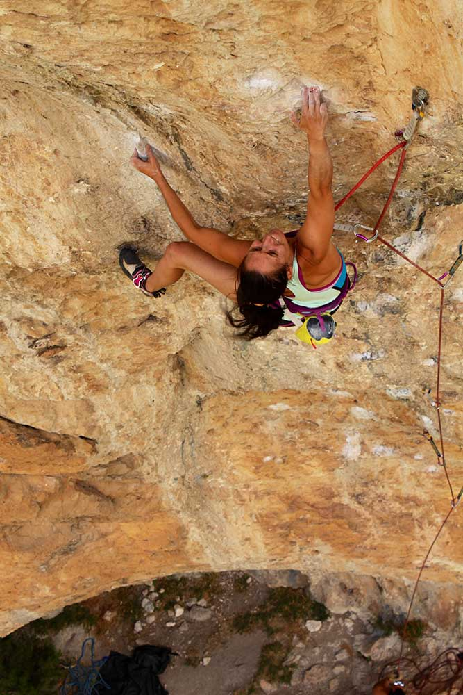 Akalski on Les Chacals (5.13d) in Rodellar. Photo by Michael Watson