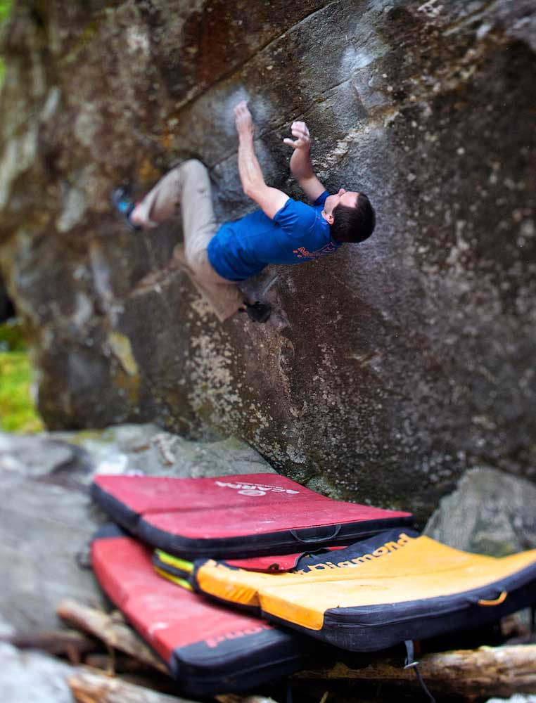 Dave MacLeod, healthy and strong, on the second ascent of Mystic Stylez (V15), Magic Wood, Switzerland. Photo: Lukasz Warzecka / PolishedProject.