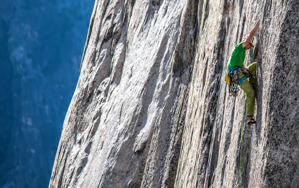Adam Ondra susses out the lower pitches of the <em>Dawn Wall</em> during his first day on the climb. Photo: Dustin Moore / <a target=