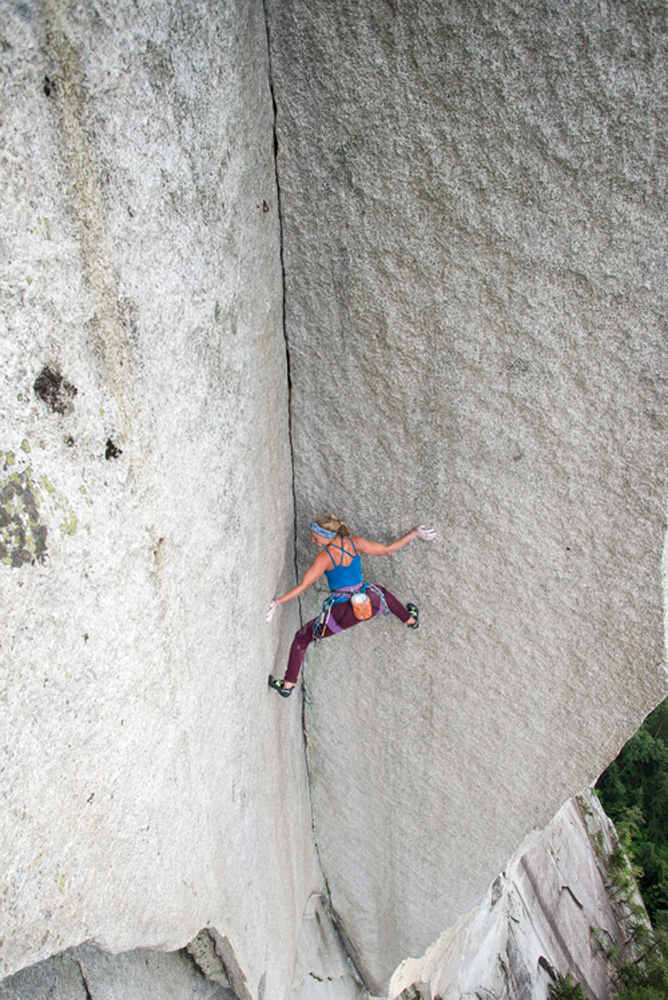 Brette Harrington stems the <em>Shadow</em> (5.13-) in Squamish, British Columbia, Canada. Photo: Rich Wheater / REEL ROCK.