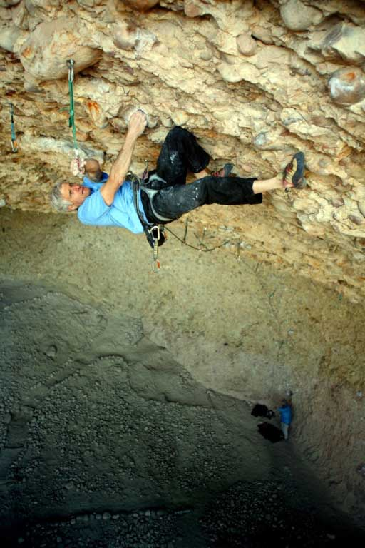 Sheftel climbing <em>The Whole Shot</em> (5.13d/.14a).&#8221; />At 68 years old,<span style=