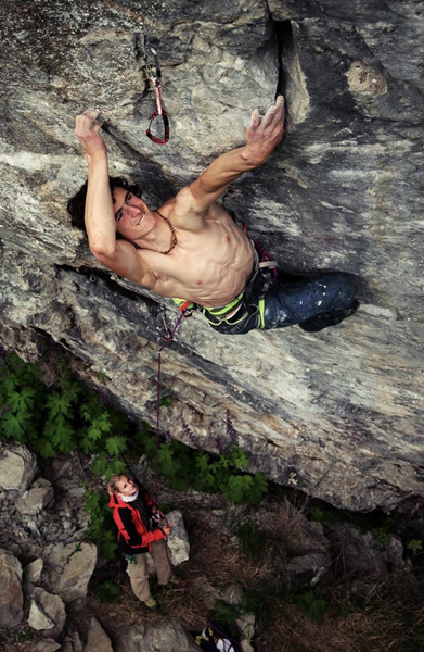 Ondra attempting a 5.15a project at the Hell Crag, Norway. Photo by Petr Pavlíček.