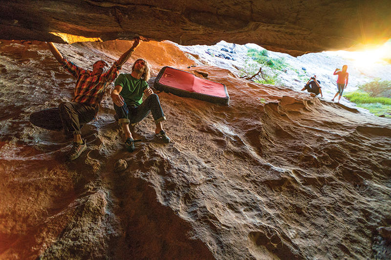 Belhaj shows Chris Sharma the beta on <em>Wheel of Life</em> (V15), Hollow Mountain Cave, Grampians, Australia, before Sharma's flash attempt. The five foot, five inch Belhaj climbed 95 percent of The Wheel, only to be discouraged by the reachy final V12 exit. Photo: Andrew Bisharat.