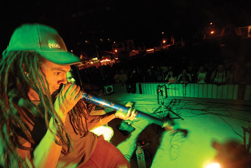 Belhaj makes music in France in 2006. Photo: Sam Bie.