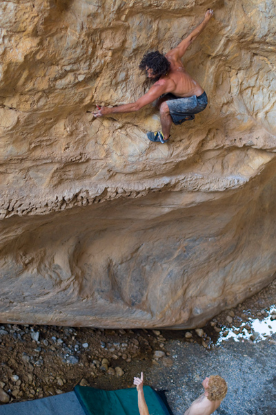 Wes Walker going ground-up above two pads for a first ascent of a 30-foot problem in northern Mexico. Photo: Boone Speed.