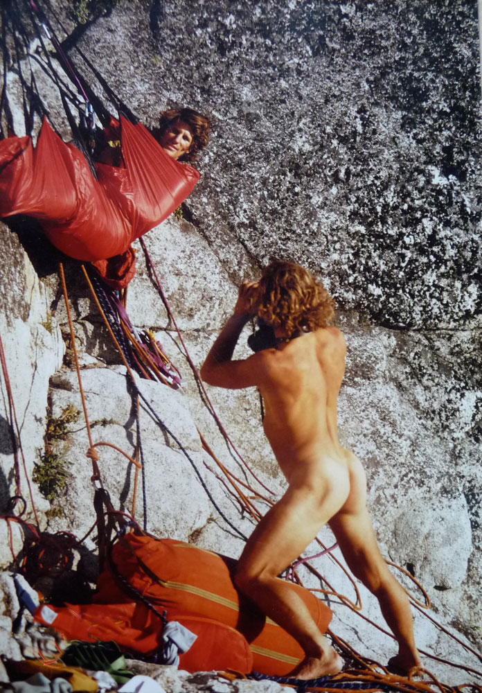 Doug Robinson snaps a shot of Galen Rowell for a National Geographic story on the first hammerless ascent of Half Dome, in 1974. Photo by Dennis Hennek.