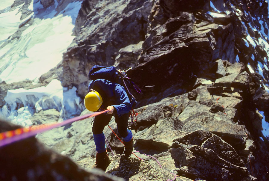 "A climber rappelling the <em>West Ridge</em> on Forbidden Peak."" title=""A climber rappelling the <em>West Ridge</em> on Forbidden Peak.""><b style="