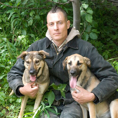 Todd Serious with his dogs. Photo courtesy of The Rebel Spell.