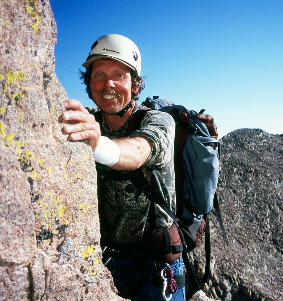 Jim on <em>Kieners Route</em>, Longs Peak, Colorado. His wrist is wrapped on account of a recent bite from his pet Caiman, Liz. Photo courtesy of Rebecca Detterline.